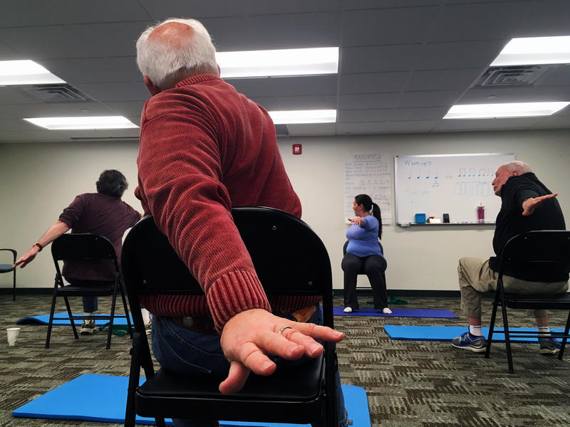 Bonnie Hoolihan leads BRiTE participants in chair yoga on Friday, February 17, 2017.