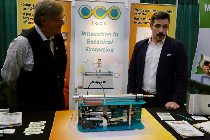 Jim Lively (left) and Chris Lively of OCO Labs explain their carbon dioxide extraction system at the World Medical Cannabis Conference & Expo on April 21-22, 2017.