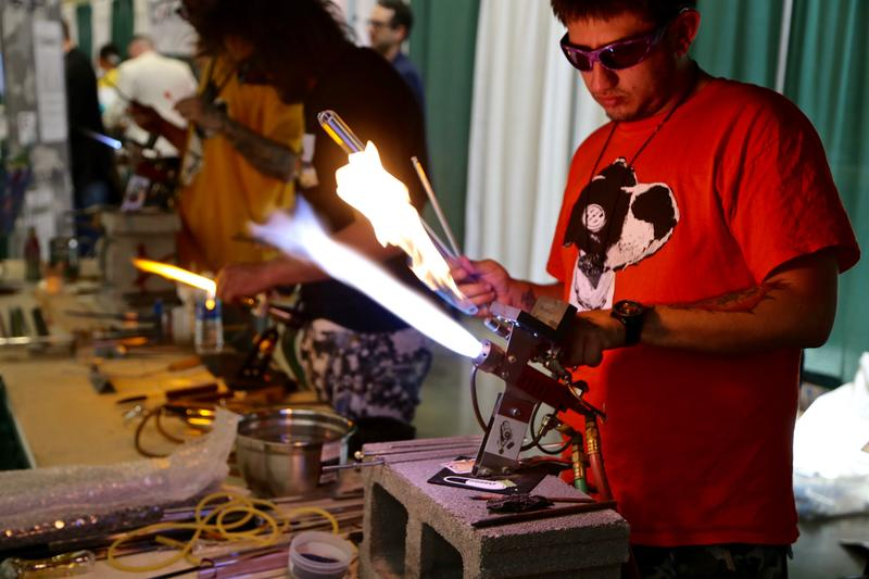 Roland Hex works with a glassblowing torch at the World Medical Cannabis Conference & Expo on April 21, 2017.