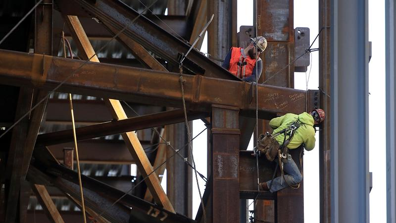 Job growth is a primary driver of the housing market. In this Oct. 3, 2015 file photo, iron workers help build the Comcast Innovation and Technology Center in Philadelphia.