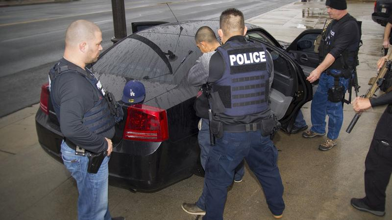 In this Tuesday, Feb. 7, 2017 photo released by US Immigration and Customs Enforcement, foreign nationals are arrested during a targeted operations aimed at immigration fugitives, re-entrants and at-large criminal aliens.