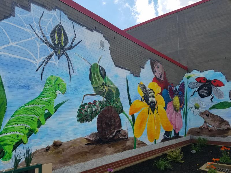 A mural is painted above the shade garden at the Fort Cherry Discovery Zone, which opened Tuesday.