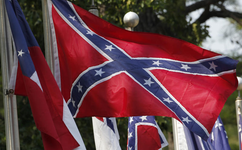 In this July 9, 2011 file photo, Confederate battle flags fly in Mountain Creek, Ala.