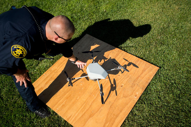 Alameda County Sheriff's Deputy Dave Durbin prepares to fly a drone during a demonstration in Dublin, Calif., on Aug, 14, 2015. Some police agencies admitted at the time to flying their aircraft without realizing they needed approval from the FAA.