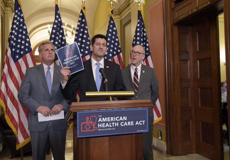 House Speaker Paul Ryan of Wis., center, standing with Energy and Commerce Committee Chairman Greg Walden, R-Ore., right, and House Majority Whip Kevin McCarthy, R-Calif., left, speaks during a news conference on the American Health Care Act.