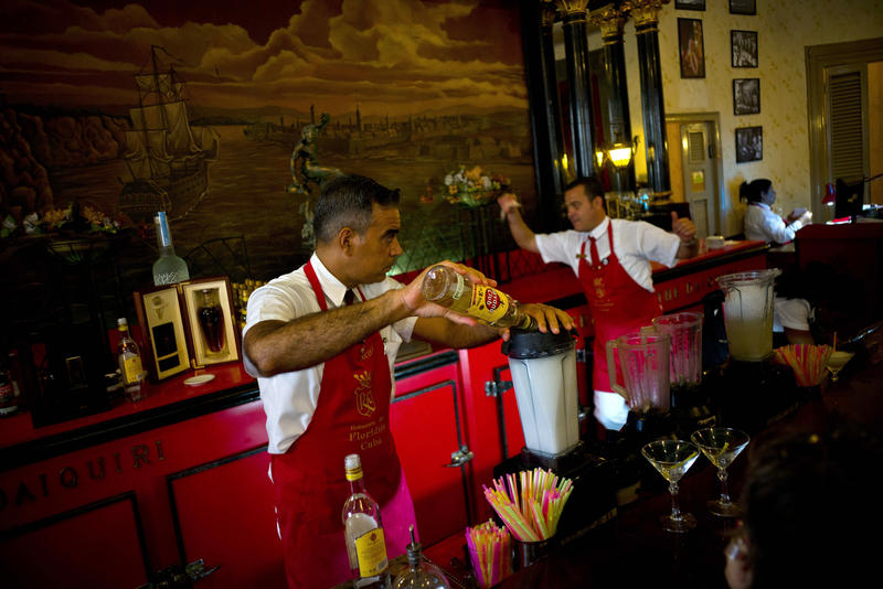 In this Friday, April 28, 2017 photo, a bartender pours Cuban Havana Club rum as he prepares daiquiris at the Floridita bar in Havana, Cuba. The agency that controls Pennsylvania's state-owned wine and liquor stores aims to lift the embargo on Cuban rum.