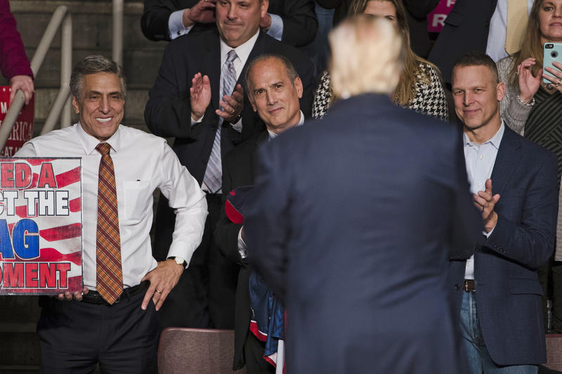 Pennyslvania Republicans U.S. Rep. Lou Barletta (left), U.S. Rep. Tom Marino (center) and U.S. Rep. Scott Perry (right) watch as Donald Trump departs a rally in Hershey, Pa., in Dec. 15, 2016.