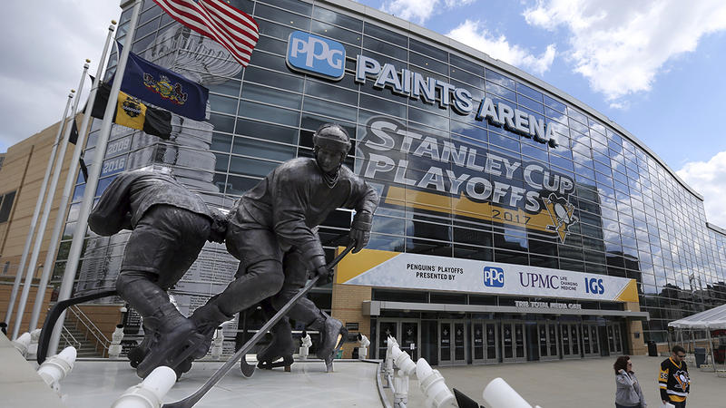 Fans walk past the entrance to PPG Paints Arena before Game 1 of the Eastern Conference final in the NHL hockey Stanley Cup playoffs between the Pittsburgh Penguins and the Ottawa Senators, Saturday, May 13, 2017, in Pittsburgh.