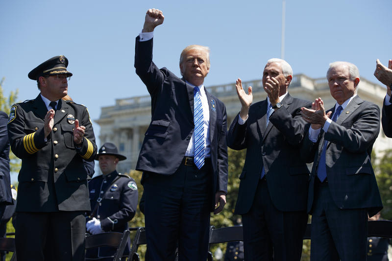 President Donald Trump pumps his fist beside national FOP president Chuck Canterbury (left), Attorney General Jeff Sessions and Vice President Mike Pence during the 36th annual National Peace Officers Memorial Service on Capitol Hill, May 15, 2017.