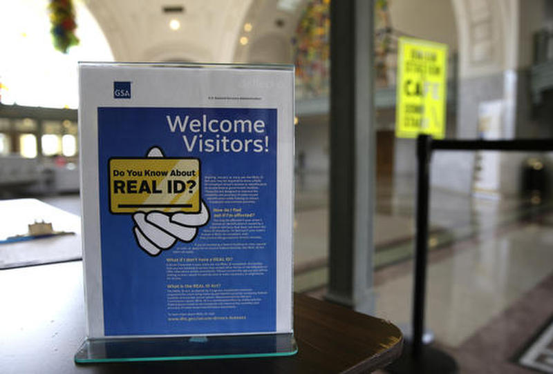 A sign at the federal courthouse in Tacoma, Wash., informs visitors of the federal government's REAL ID act, which requires state-issued driver's licences and ID cards to have new security enhancements that comply with legal U.S. residency standards.