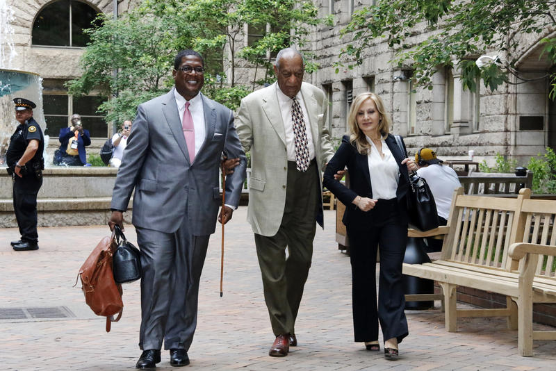 Bill Cosby, center, arrives with one of his attorneys Angela Agrusa, right, for the second day of jury selection in his sexual assault case at the Allegheny County Courthouse, Tuesday, May 23, 2017, in Pittsburgh.