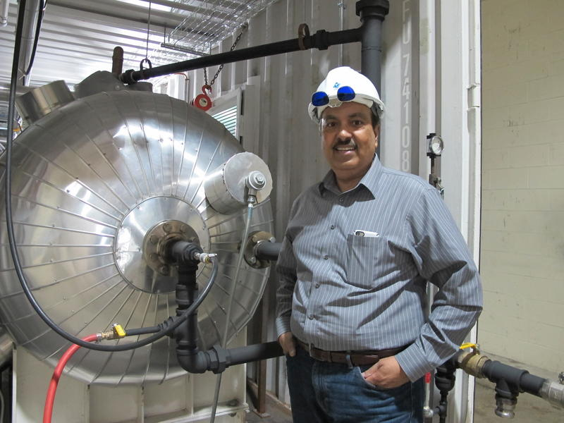 AquaSource President and CEO Shyam Dighe stands next to the company's 70 barrel a day demonstartion facility in Mt. Pleasant, PA. The porposed production units will handle 6,000 to 12,000 Barrels a day.