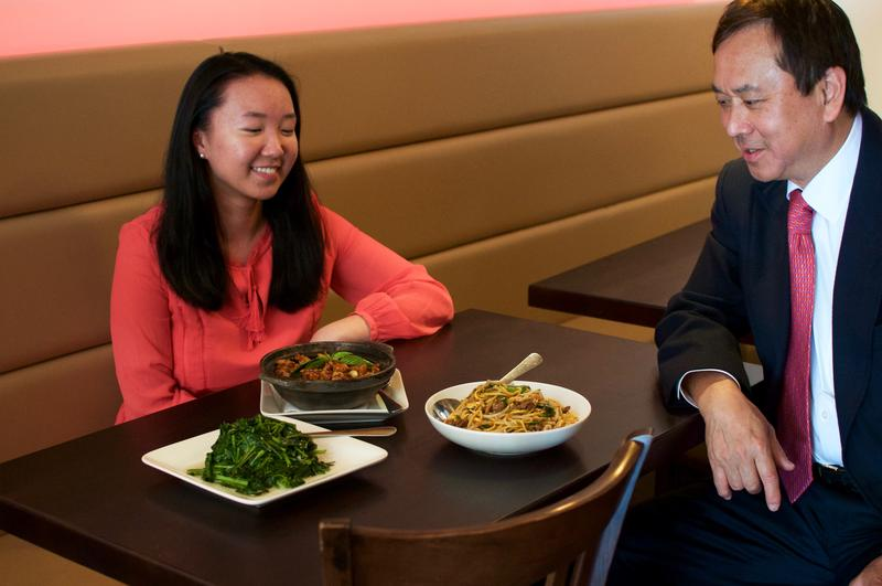 Anna Wan and Dr. Freddie Fu converse over a meal, which is a typical way to meet.