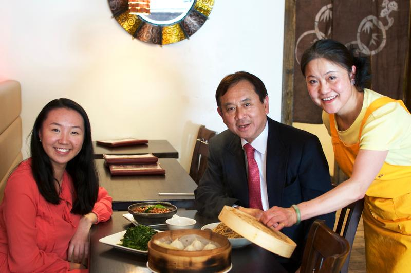 "Meiching ""Jenny"" Tao reveals soup dumplings under the lid of a bamboo steamer. She is joined by Dr. Freddie Fu and Anna Wan at her restaurant in Squirrel Hill on April 26th, 2017."