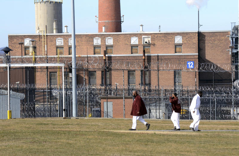 Inmates walk across the yard at the State Correctional Institute at Camp Hill on Friday, January 13, 2017.