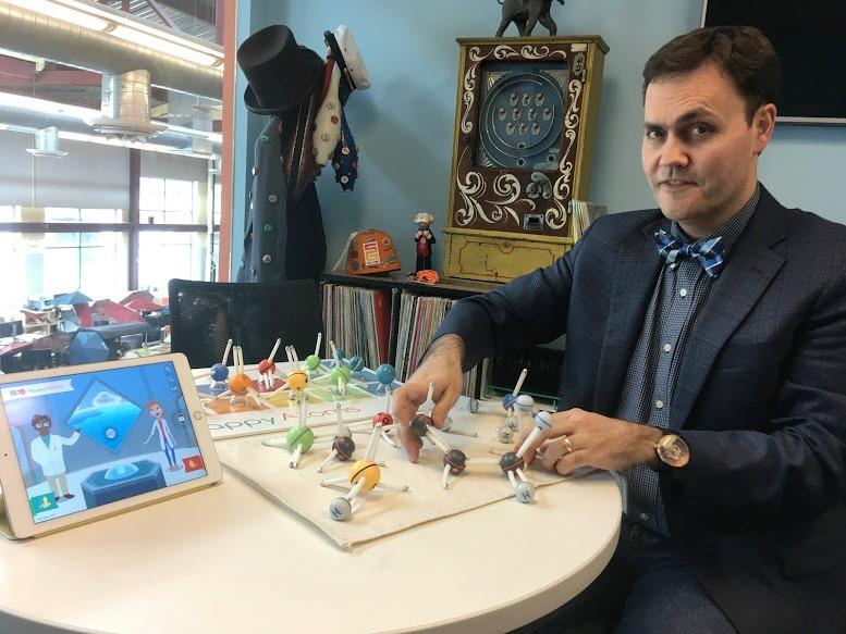 Jesse Schell of Schell Games demonstrates the game Happy Atoms at Schell's south side offices on Friday, April 28, 2017.
