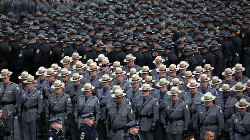 Pennsylvania State Troopers and police officer from around the country line up outside the Blair County Convention Center in Altoona, Pa., following a memorial service Thursday, Jan. 5, 2017, for State Trooper Landon Weaver, killed in the line of duty.