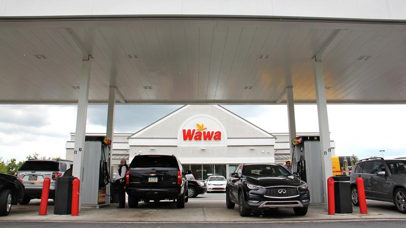 Customers fuel up at the Wawa on Bartram Avenue in southwest Philadelphia, Pa.