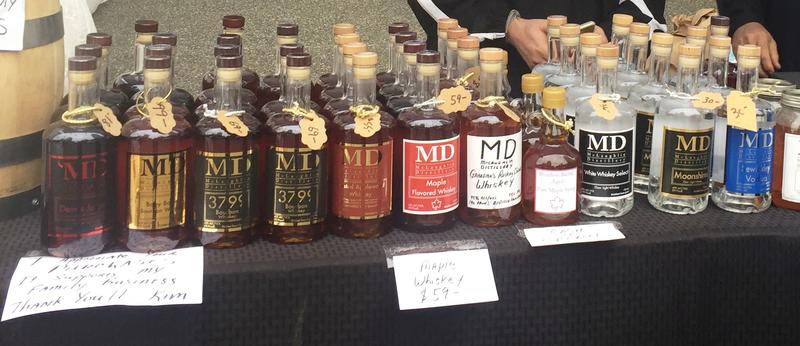 Whiskey, vodka and moonshine are among the products sold at the McLaughlin Distillery tent at the Market Square Farmers Market in downtown Pittsburgh. It's the first full season distilleries and breweries are allowed to participate in the markets.