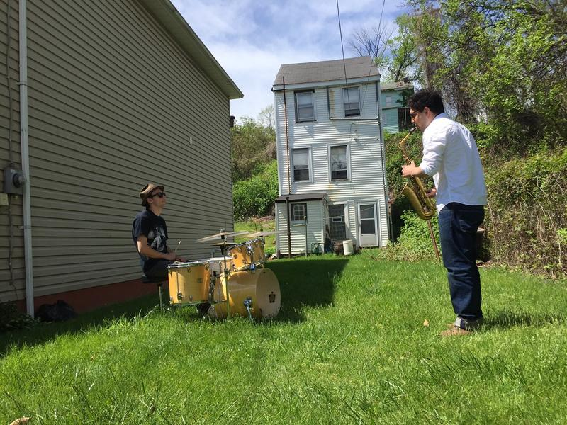 Musicians David Lyttle (left) and Tom Harrison (right) play a medley of Art Blakey jazz songs in the Hill District, on the site of Blakey's childhood home.