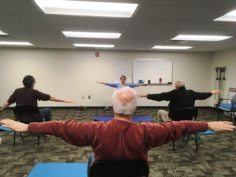 Senior citizens participate in yoga at the University of Pittsburgh's BRiTE program on Friday, February 17, 2017.