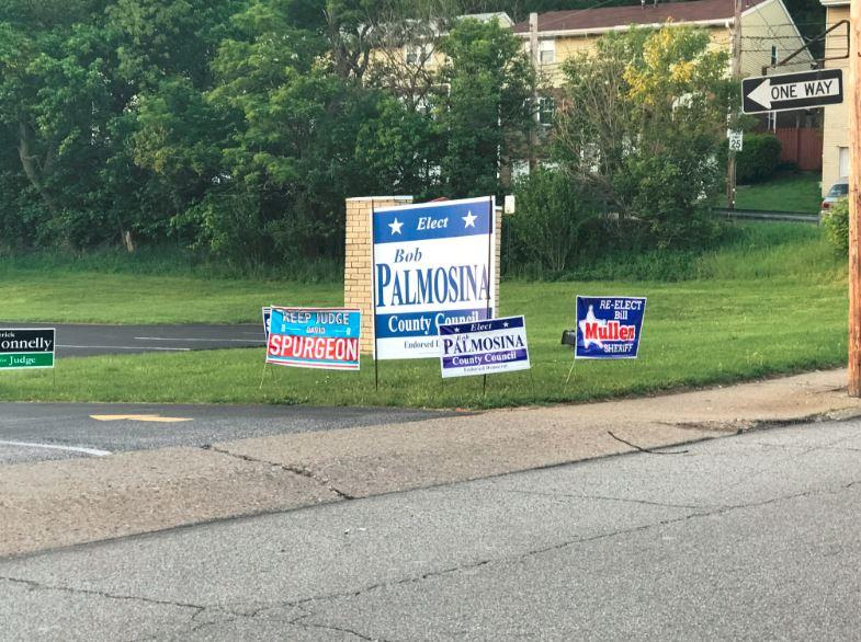 Campaign signs outside of the polling location at Ascension Church in Crafton.