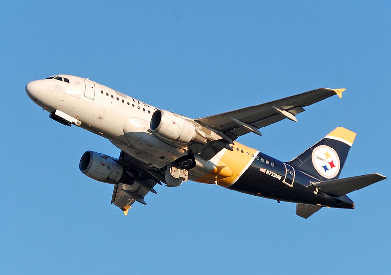 A plane with Pittsburgh Steelers colors at Charlotte-Douglas International Airport.