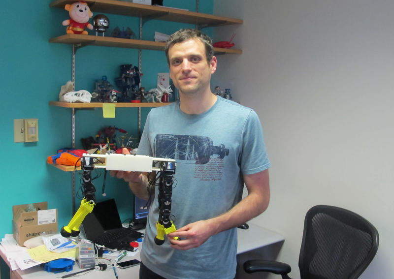 Carnegie Mellon University Assistant Professor Stelian Coros shows off one of the first robots created using his software and a 3D printer.