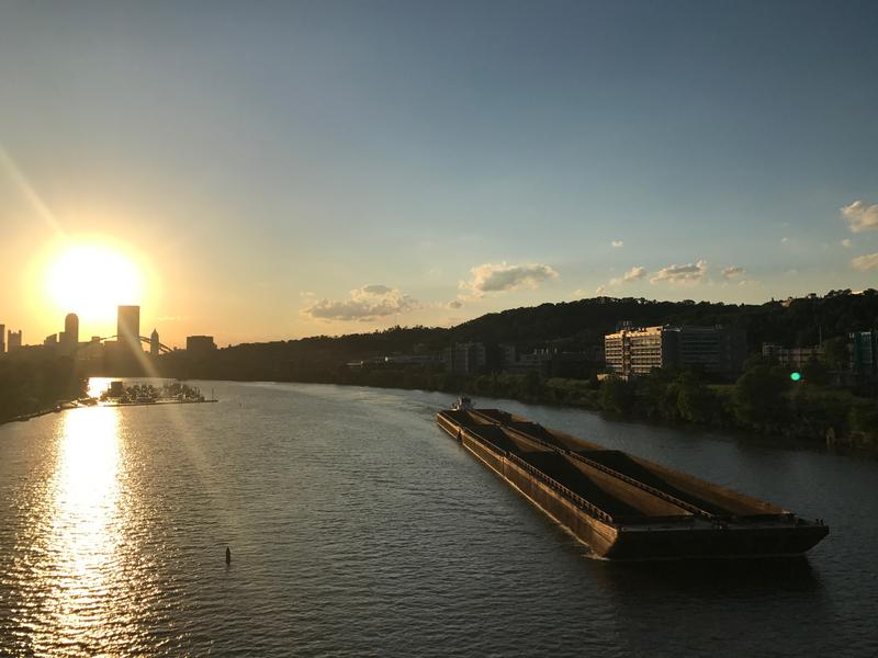 A barge moves up the Monongahela River. The locks and dams on the region's rivers ensure that they remain navigable.