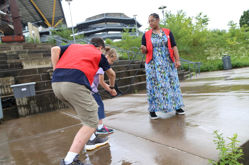 Science Center employees help with the snowball slingshot.