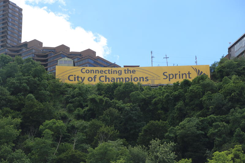 The Sprint sign along Mt. Washington has been updated, but some residents still aren't happy about it.