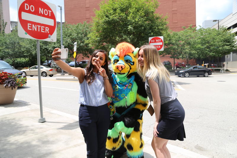 Teena Pandey, of Pittsburgh, poses for a selfie with Dart, who came from Alabama to attend their second Con.