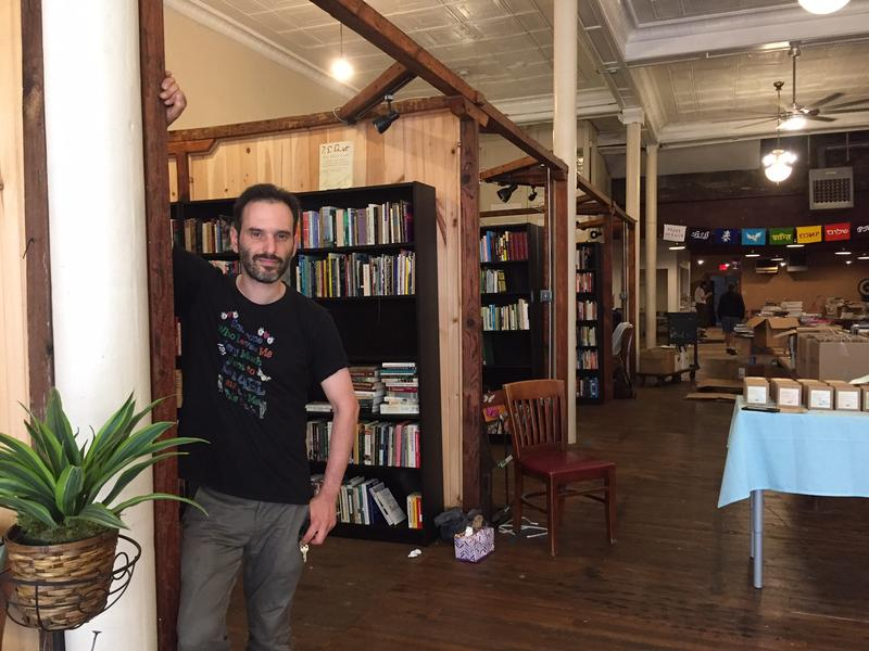 Eric Ackland, owner of Amazing Books and Records Emporium, amid the stacks at his third location on the South Side.