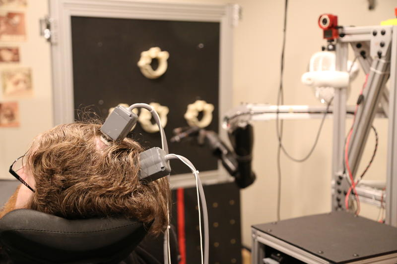 Nathan Copeland, who is functionally paralyzed from the neck down, works with researchers while attempting to move a robotic arm with his mind on Thursday, Oct. 27, 2016. Medical research such as this would be supported by a new initiative from Pitt.