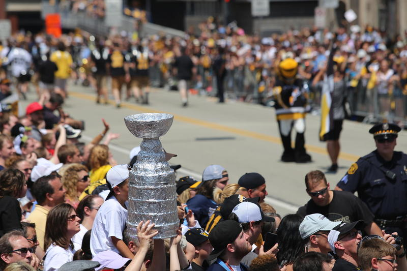Thousands line the parade route through Downtown Pittsburgh on Wednesday, June 15, 2016, to watch the Penguins take a victory march.
