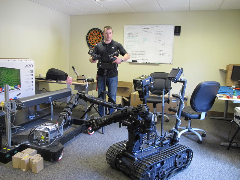RE2 engineer Aaron Nicely remotely controls a set of arms it sells to the U.S. Department of Defense for use on bomb disposal robots.