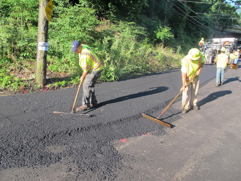 Public Works crews pave Saline Street in Four Mile Run.