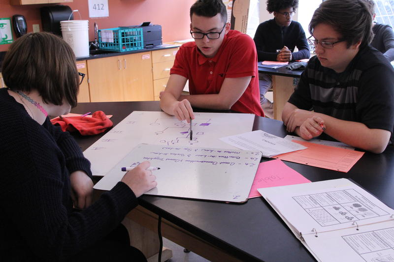 Students at City Charter High School work on a group project at the downtown school.