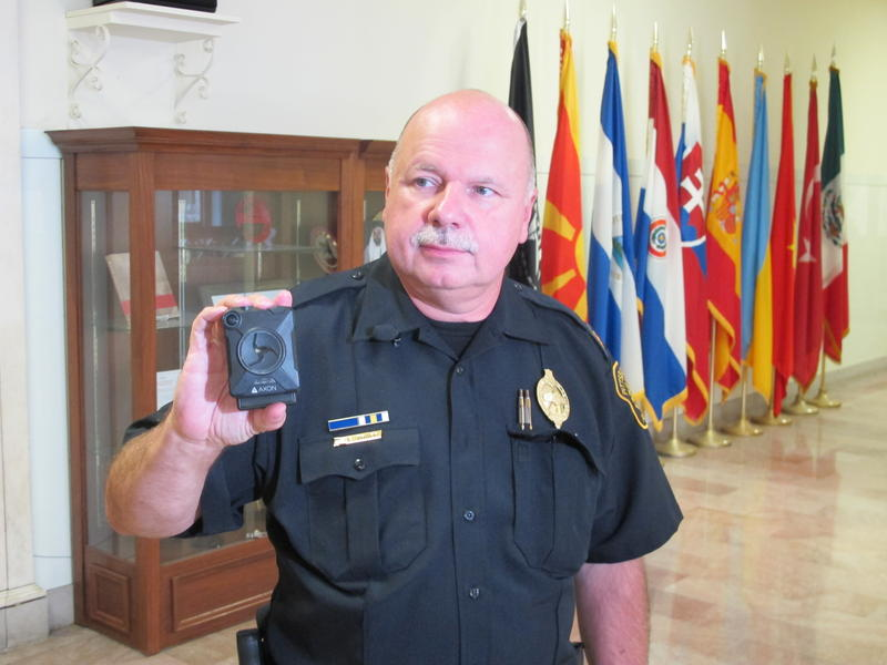 Pittsburgh Police Cmdr. Ed Trapp displays a police body camera.