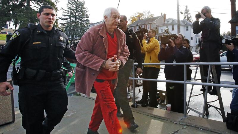 Former Penn State University assistant football coach Jerry Sandusky, second from left, arrives at the Centre County Courthouse for a hearing about his appeal on his child sex-abuse conviction in Bellefonte, Pa., Thursday, Oct. 29, 2015.