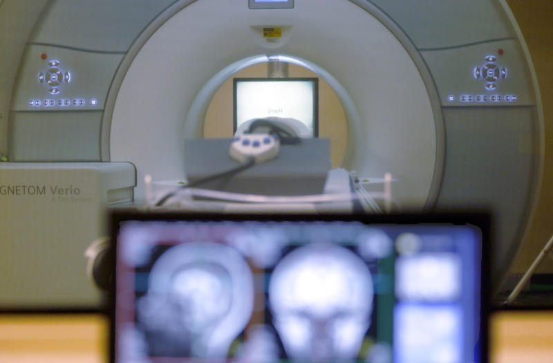 "In this Nov. 26, 2014 file photo, a brain-scanning MRI machine at Carnegie Mellon University in Pittsburgh. Researchers used MRI scans to help a computer ""read minds."""