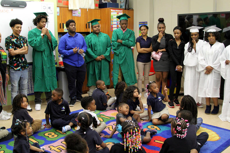 Seniors from Urban Pathways charter school tell Urban Pathways K-5 students what they will do after college. The charter emphasizes having a plan upon graduation.