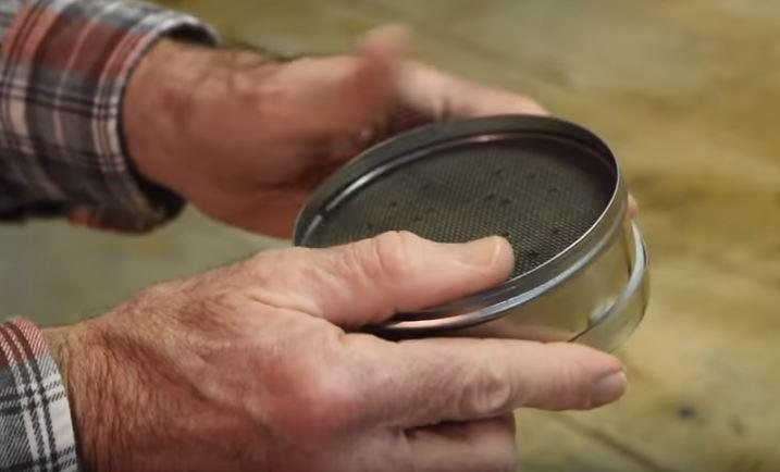 A still from a Pennsylvania Department of Environmental Protection video demonstrating how to use a radon test kit.