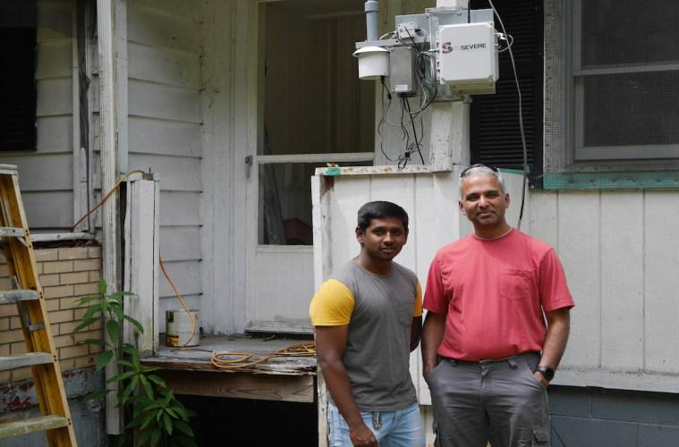 R. Subramanian (right) and his research assistant Srini Kumar attached sensors to the front porch of his house to figure out which pollutants are in the air around his home.