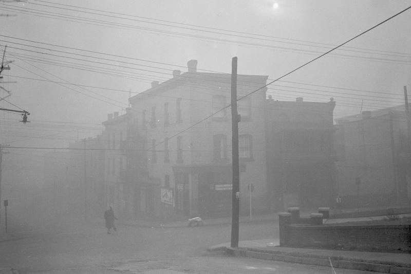 In this October 30, 1948 photo, the main business district of Donora, Pa., is cloaked in smog -- the sunlight virtually obliterated by thick, low-hanging pollution.
