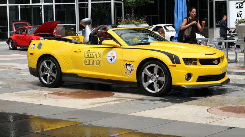 "A replica Stanley Cup sits in the back seat of the ""Terrible Camaro,"" in PPG Place ahead of the Pittsburgh Vintage Grand Prix."