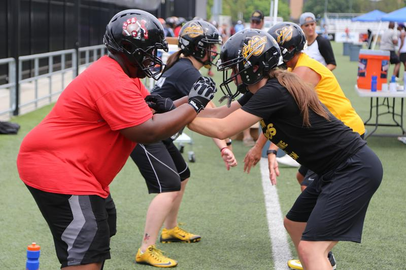 Chelsea Zahn (right), defensive tackle for the Pittsburgh Passion, practices with a member of the Derby City Dynamites, the women's football league in Kentucky on Friday, July 21, 2017.