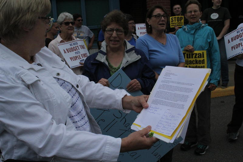 Linda Bishop, a Pine resident and constituent represented by House Speaker Mike Turzai, looks over a list of concerns Tuesday outside Turzai's McCandless office.
