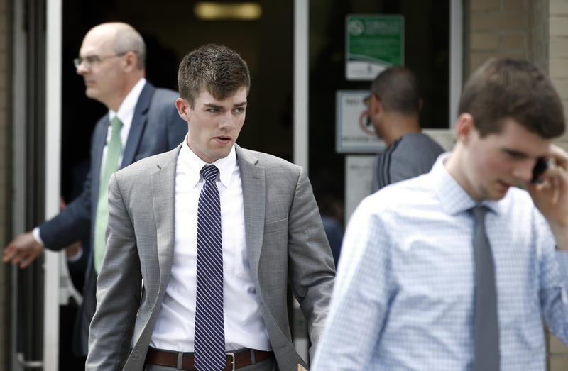 Brendan Young Jr., walks out for a lunch break during his preliminary hearing on charged related to the hazing death of Timothy Piazza. Officials announced Monday that new security footage has let them to charge 10 more in connection with Piazza's death.
