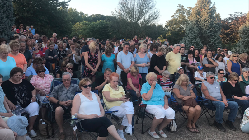 More than 1,000 people show up for a vigil in Bucks County to remember the four missing young men who were murdered by two cousins on a rural farm.